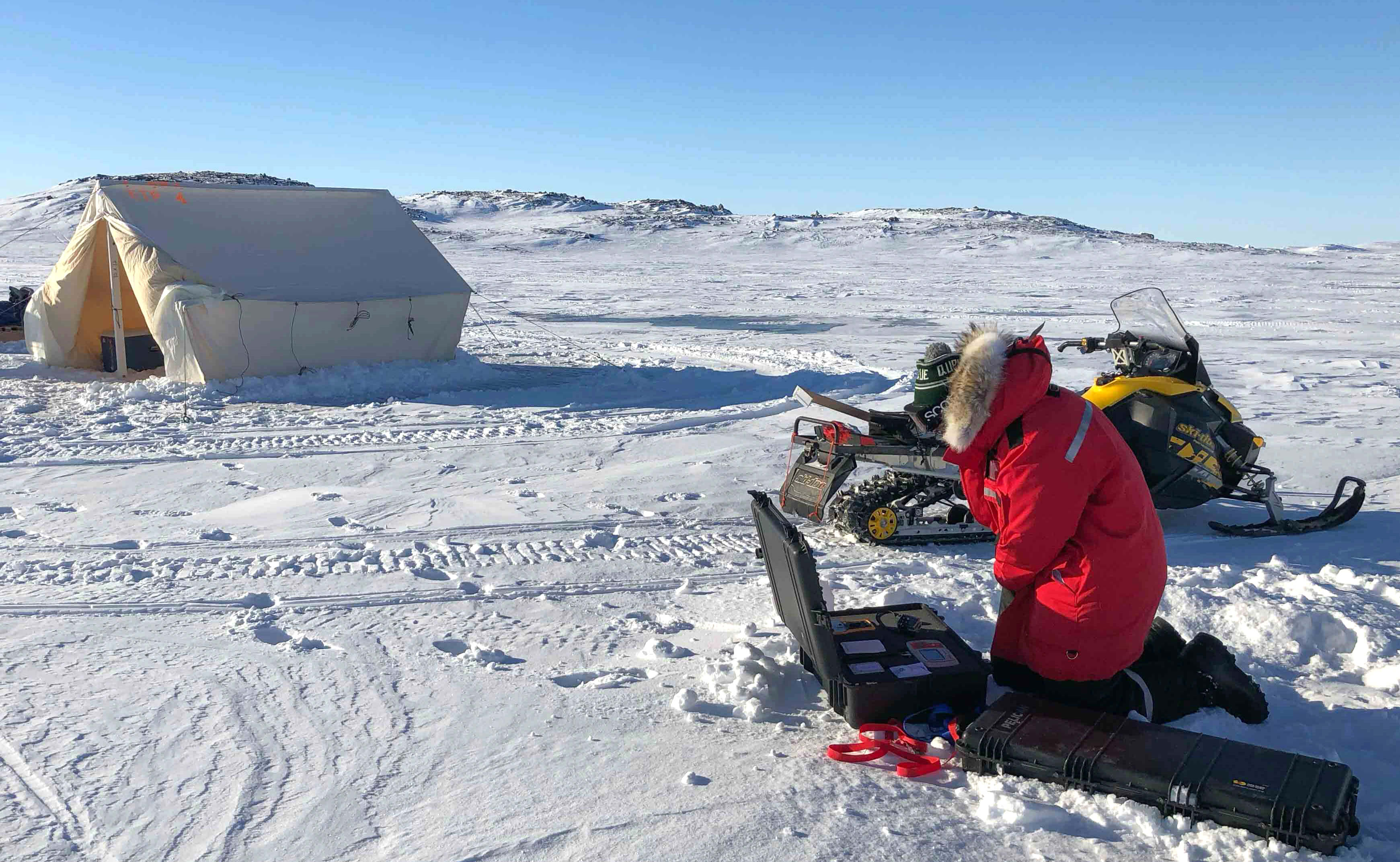 Sentinel North International Arctic Field School - Scientist deploying a sensor near Iqaluit