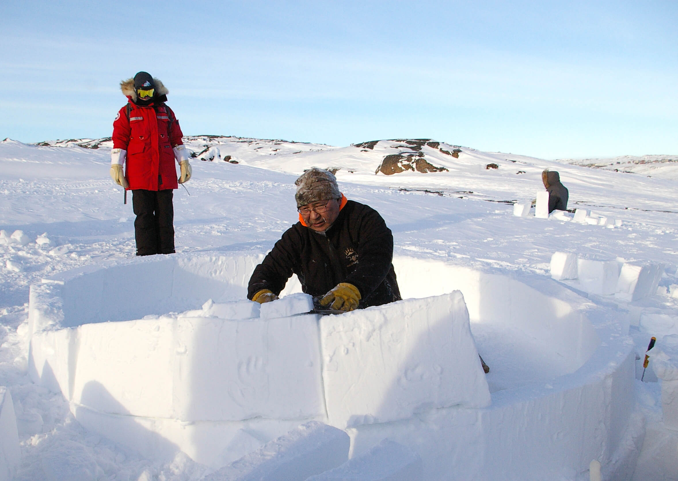Sentinel North International Arctic Field School - Inuit building an igloo near Iqaluit